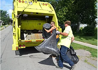Two Workers Loading Trash into a Truck